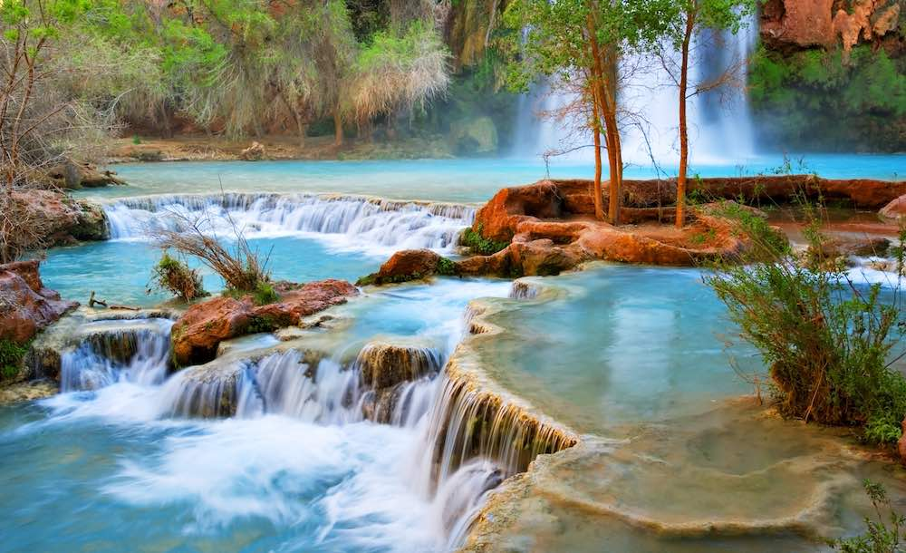 Havasu Creek tumbles from pool to pool at base of Havasu Falls in Havasupai Indian Reservation in the Grand Canyon, Arizona